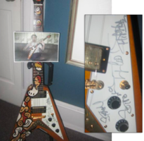 Lebo and Robert Downey Signed Guitar