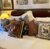 needlepoint rooster and sheep pillows